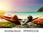 woman in hammock on tropical...   Shutterstock . vector #394402126