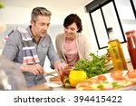 middle aged couple having fun...   Shutterstock . vector #394415422
