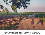 The Evening Sunset. Girl Walks...