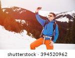 hiker in winter mountains...   Shutterstock . vector #394520962