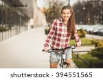 young beautiful woman on a... | Shutterstock . vector #394551565