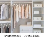 clothes hanging on rail in... | Shutterstock . vector #394581538
