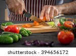 male hands cutting vegetables... | Shutterstock . vector #394656172