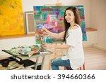 female artist working on...   Shutterstock . vector #394660366