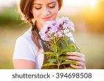 Young Gardener In Her Garden...