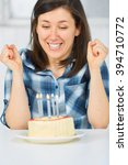 young female with birthday cake ... | Shutterstock . vector #394710772