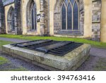 Small photo of An iron cage (known as a mortsafe) covering a grave in Greyfriars Cemetery in Edinburgh, Scotland. Mortsafes were used in the 19th century to prevent bodysnatchers from stealing corpes.