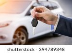 male holding car keys with car... | Shutterstock . vector #394789348