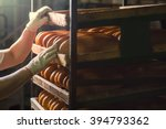 seller puts  bread on  shelf.... | Shutterstock . vector #394793362