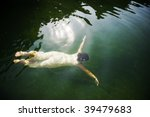 Young Woman Swimming Under...