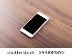 mobile phone on wooden table... | Shutterstock . vector #394884892