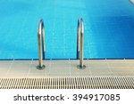 a steps in blue water pool | Shutterstock . vector #394917085