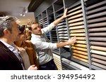 couple with salesman in kitchen ...   Shutterstock . vector #394954492