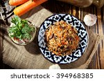 pilaf   rice with meat and... | Shutterstock . vector #394968385