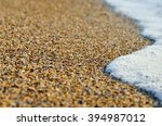 tidal wave on a clean  sandy ... | Shutterstock . vector #394987012