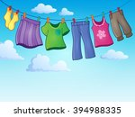 Stock vector clothes on clothing line theme image eps vector illustration 394988335