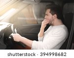 tired young man driving his car. | Shutterstock . vector #394998682