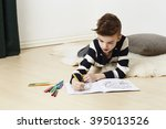 Young Boy With Coloring Book A...