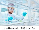 laboratory scientist working at ... | Shutterstock . vector #395017165