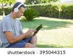 young man relaxing with a... | Shutterstock . vector #395044315