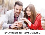 happy couple on a date looking... | Shutterstock . vector #395068252