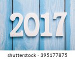 white word of 2017 on wooden... | Shutterstock . vector #395177875