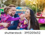 family with little girls... | Shutterstock . vector #395205652