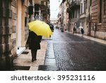 woman with yellow umbrella is... | Shutterstock . vector #395231116
