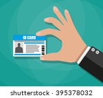 Stock vector cartoon businessman hand holding id card vector illustration in flat design on green background 395378032