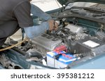 mechanic repairs a car in a... | Shutterstock . vector #395381212