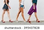 legs of women on city street | Shutterstock . vector #395437828