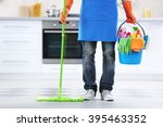 man holding mop and plastic... | Shutterstock . vector #395463352