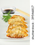 Fried Pot stickers, Dumplings, Traditional Asian Food, Stuffed with Pork Meat or Vegetables - stock photo