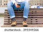 hipster guy sitting on bench... | Shutterstock . vector #395549266