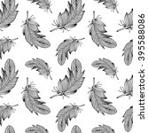 hand drawn feathers pattern.... | Shutterstock .eps vector #395588086