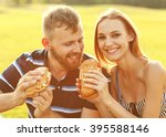 couple sitting on the grass in...   Shutterstock . vector #395588146