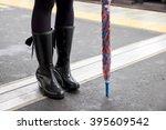 woman legs and umbella | Shutterstock . vector #395609542