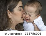 young mother trying to comfort... | Shutterstock . vector #395756005