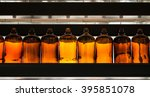 row of dusty brown glass... | Shutterstock . vector #395851078