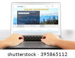 man using laptop to book hotel... | Shutterstock . vector #395865112