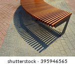 Bench And Shadow On The Street