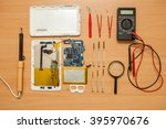 disassembled tablet and tools... | Shutterstock . vector #395970676