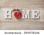 Small photo of Home sweet home, wooden text on vintage board background with copy space