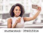 pleasant girl making photos | Shutterstock . vector #396015316