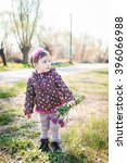 a little girl walks outdoor | Shutterstock . vector #396066988