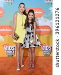 Small photo of LOS ANGELES - MAR 12: Maddie Ziegler & Mackenzie Ziegler arrives to the Nickeloden's Kid's Choice Awards 2016 on March 12, 2016 in Hollywood, CA.