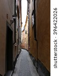 Small photo of A narrow alleyway in the old town of a picturesque, quaint European village.