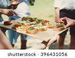 canape with avocado  goat... | Shutterstock . vector #396431056
