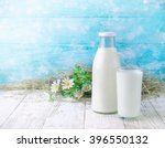 a bottle and glass of milk on a ... | Shutterstock . vector #396550132