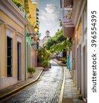 colorful street in old san juan ... | Shutterstock . vector #396554395